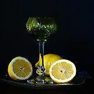 Wine glass, lemons and fish plate by Gilberte