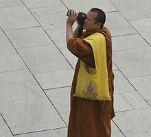 MONK TAKING A PHOTO by andysax