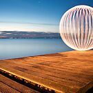 orange orb - on the jetty by Julian Marshall