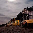 torch lit beach huts by Julian Marshall