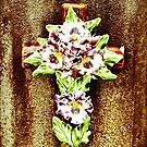 Ceramic Flower on Cross by Jason Dymock Photography