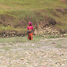Woman Crossing River Bed by Sati
