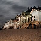 norfolk beach huts by torch light by Julian Marshall
