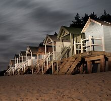 norfolk beach huts by torch light by Julian Marshall