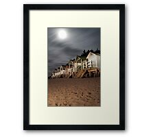 norfolk beach huts by torch light Framed Print