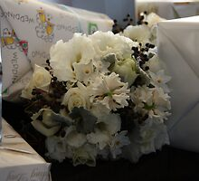 Bridesmaids bouquet amongst the gifts. by CapturedByKylie