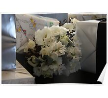 Bridesmaids bouquet amongst the gifts. Poster
