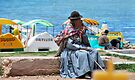 Bolivian Lady by the Shore of the Lake by Alessandro Pinto