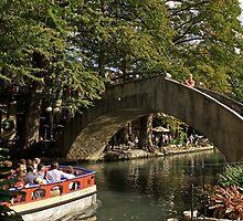 Riverwalk bridge and boat by lizzclements