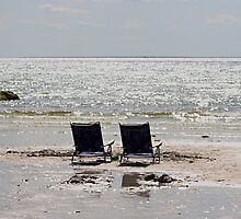 Two beach chairs on a sand bar by Linda Crockett