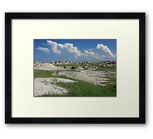 Clouds And The Badlands Framed Print
