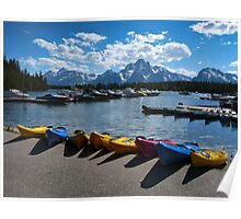 Red, Yellow and Blue Canoes on Shore Poster