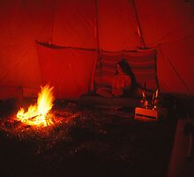 Joann beside the fire inside her tipi by Jens Didriksen
