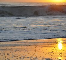 sunrise on the beach by mickels