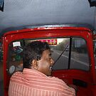 Tuc tuc driver by Chris  Hitchiner