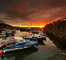 Carnlough Harbour welcomes another sunrise.  by Fred Taylor