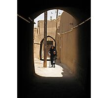 Veiled woman in the streets of Yazd, Iran Photographic Print