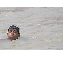 A young kid in Ganga Photographic Print