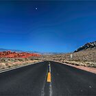 Open red rock road by Sylvain Dumas