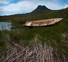 A small boat. A big mountain by chriscyner