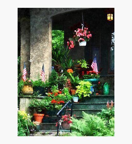 Porch With Geraniums and American Flags Photographic Print