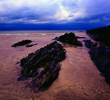 Rocks in sea at Saunton sands by Michael Schmid