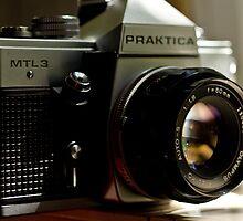 Praktica SLR with Olympus Zuiko 50mm lens by harper white