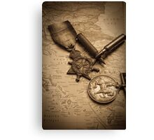 WW1 medals over atlas Canvas Print