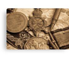 WW1 medals over atlas Canvas Print