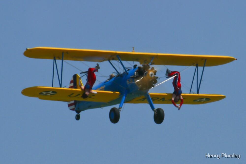 The Stearman Wingwalkers hanging upside down by Henry Plumley