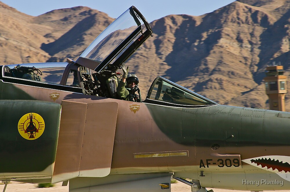 The pilot of the F-4 Phantom waves to the crowd. by Henry Plumley