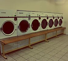 Seven Washing Machines and a Bench by Matthew Floyd