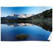 sunrise reflection of mountain peak to the lake Poster