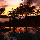 Tropical Sunset with refelection in the pool by Guy Tschiderer