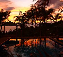 Tropical Sunset with refelection in the pool by Guy C. André Tschiderer