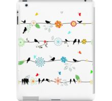 Birds on a wire with brightly colored flowers. iPad Case/Skin