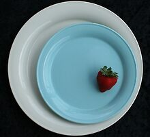 strawberry on a blue plate by Hope A. Burger