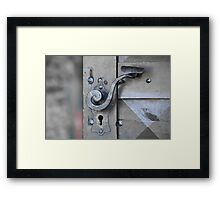Ancient door handle on the gates Framed Print