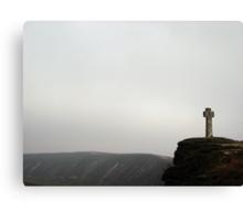 an ancient cross atop a cliff. Canvas Print