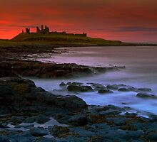 Dunstanburgh Castle at sunset by Darren Turner