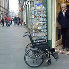 wheelchair left outside shop by H J Field