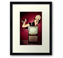 Blond on a TV Framed Print