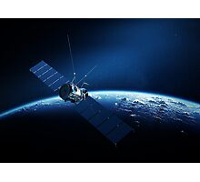 Communications satellite orbiting earth Photographic Print