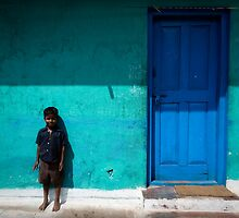 Boy by blue door by Mark Smart