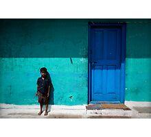 Boy by blue door Photographic Print
