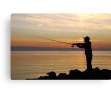Fisherman at sunset Canvas Print
