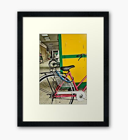 yellow back bike Framed Print