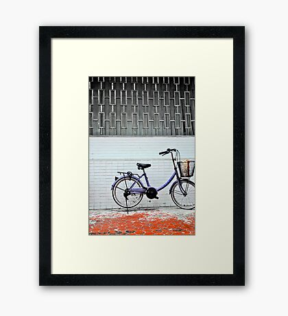 red ground bike Framed Print