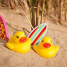 Rubber Duckies Hanging Out On Beach by John Hartung