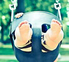 Swinging Baby's Chubby Feet by Andrea Moffatt